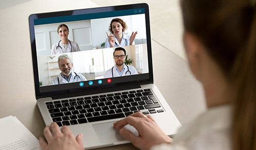 image of patient facing four doctors on a laptop