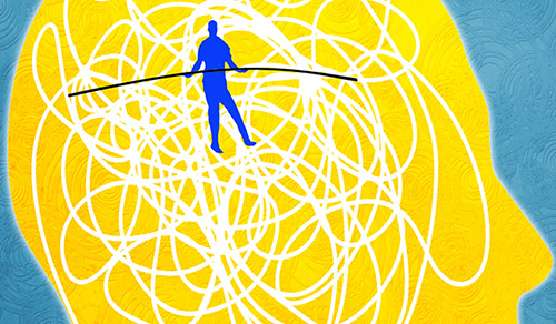 a man walking a tightrope